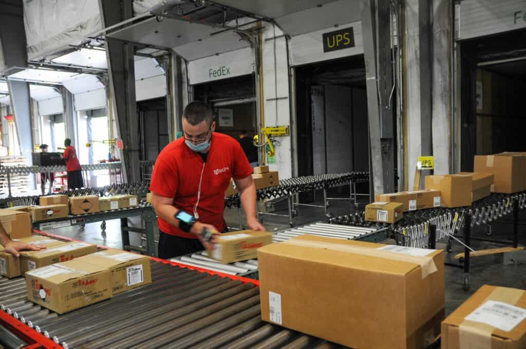 Loading packages when carriers arrive during the COVID/holiday peak season.