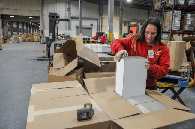 A Red Stag team member picking and packing product.