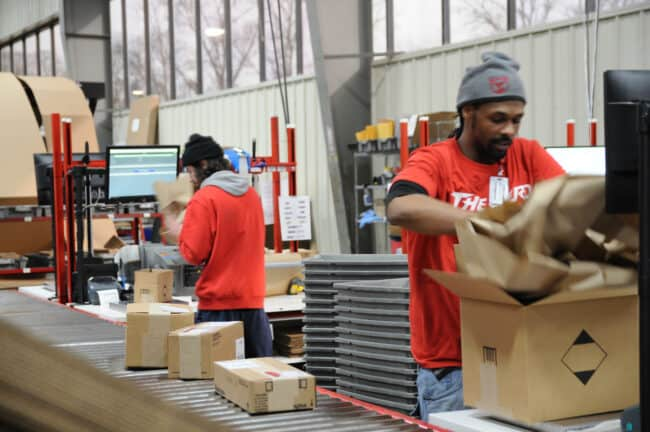 Picking and packing inside the Red Stag fulfillment warehouse